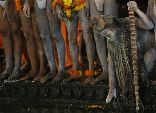 The Associated Press | Naked Hindu holy men wait to bath in the Godavari River during Kumbh Mela, or Pitcher Festival, at Trimbakeshwar in Nasik, India, Saturday, Aug. 29, 2015. Hindus believe taking a dip in the waters of a holy river during the festival, will cleanse them of their sins. According to Hindu mythology, the Kumbh Mela celebrates the victory of gods over demons in a furious battle over a nectar that would give them immortality. (AP Photo/Rajanish Kakade)