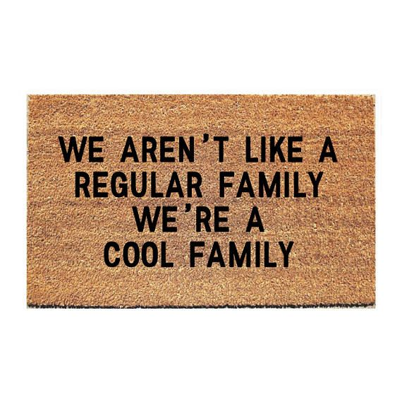 We Arent Like a Regular Family Were a Cool Family Doormat. Size: 18 x 30; Approximately .75 thick. Material: 100% coir with rubber backing. Weight: Approximately 4.5lbs Weight: Our doormats weigh approximately 4-5lbs. Design: Handpainted; Outdoor Paint ORIGINAL DESIGN by Fox and