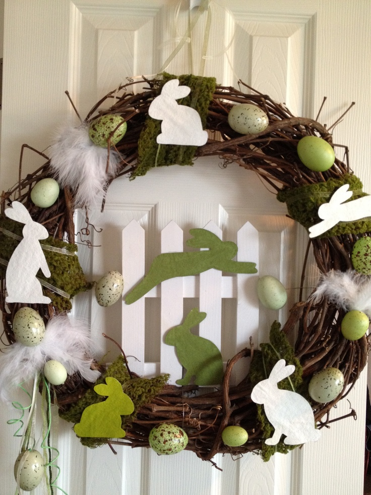 I painted the bunnies on drop-cloth fabric with acrylic paint and then cut them out, painted the edges then applied them to my wreath.