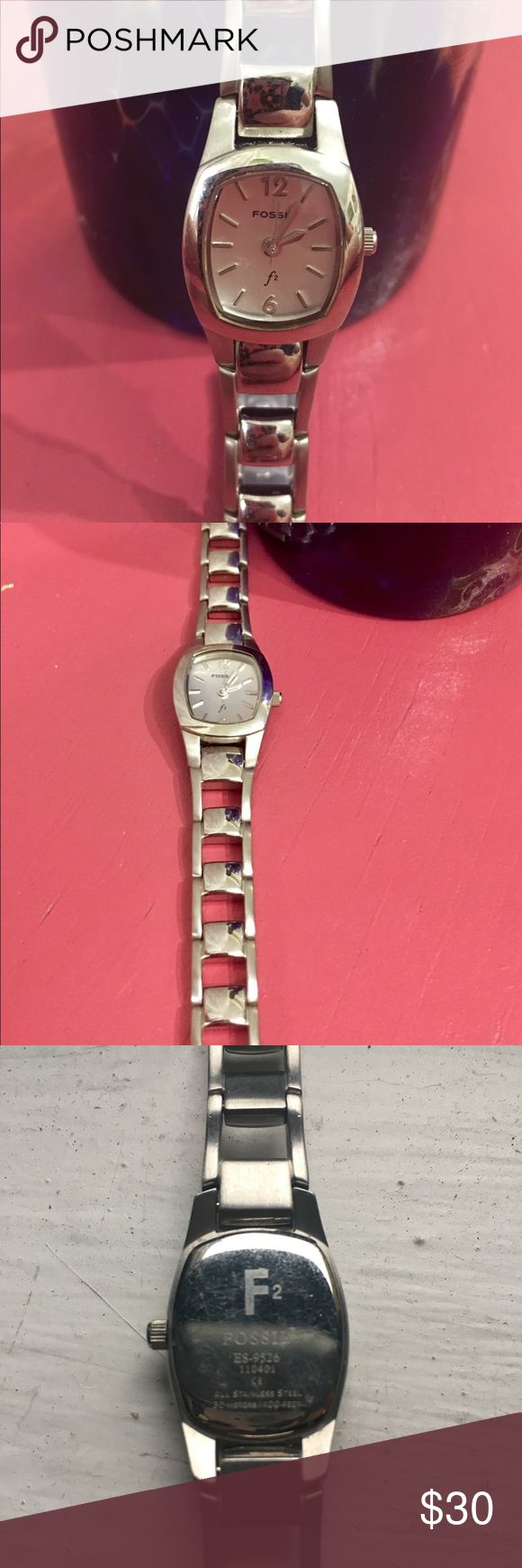 Stainless Steel Watch Never worn. There is an extra link attached. This never fit me correctly. The battery may need to be replaced. Measures 6.6 inches with extra link attached. Fossil Accessories Watches
