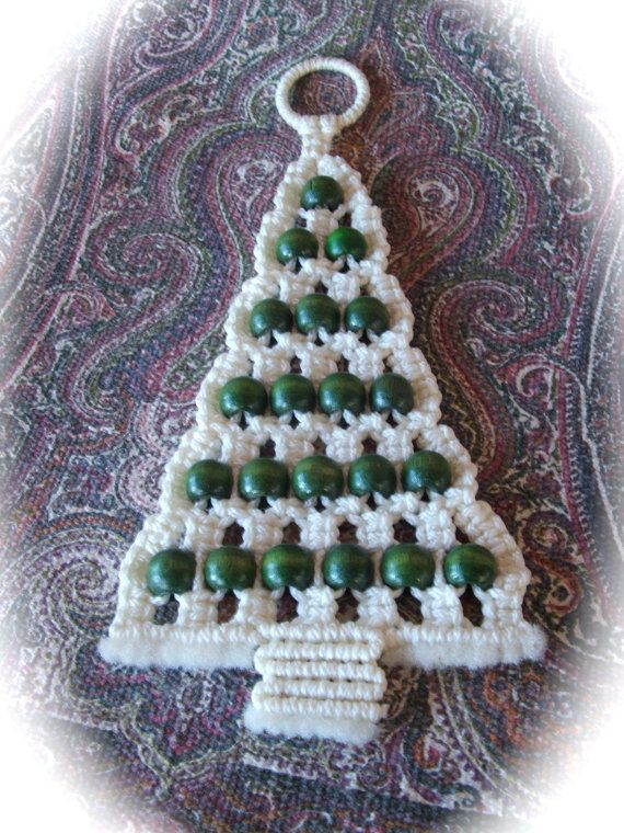 Very nicely crafted handmade vintage 1970s macrame Christmas tree wall hanging in green and white measures 15 tall and 6.5 at the widest.