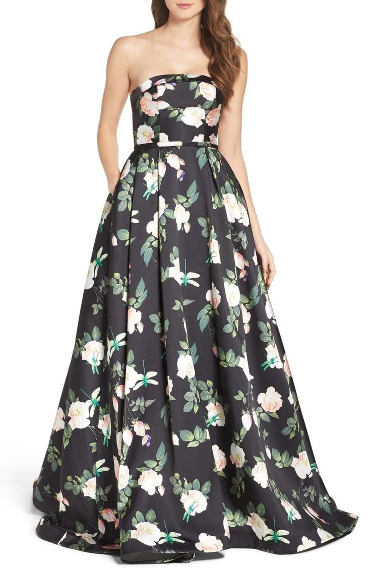 The clean lines of a bustier-structured bodice offer balance to the extravagantly full and sweeping skirt of this enchanting strapless faille ballgown abloom in a drifting botanical print.