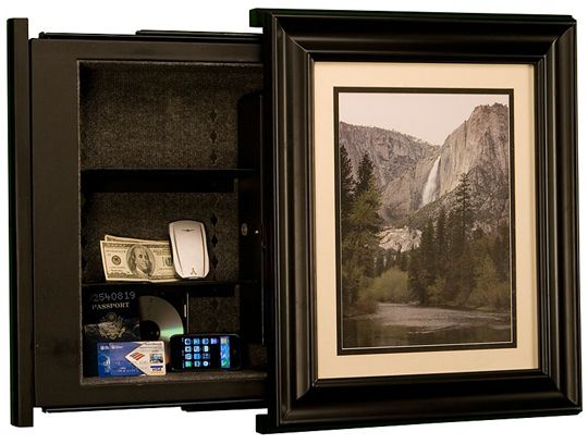 Hidden safe behind a framed picture.   Love this.
