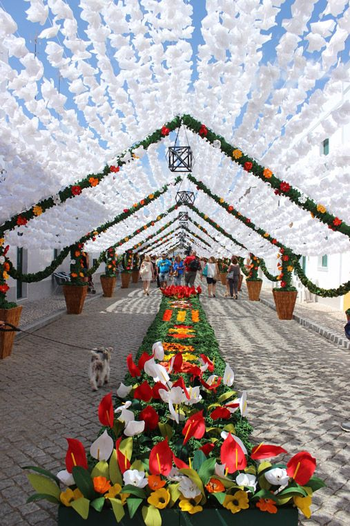 Why you should go to Flowers' Festival in Alentejo, Portugal | Vua Where to Go Blog | 25/08/2015 fter four years, The Flowers' Festival also known as People's Festival (in Portuguese Festas do Povo / Festas das Flores ) is back on the streets of Campo Maior in Alentejo.  Like reading a description paragraph in a book – this is how surreal this festival looks at first sight! Before arriving to the city, we would imagine no more than four-five decorated streets.  #Portugal