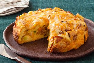 Slow-Cooker Cheesy Bacon Strata 10  eggs 2-1/2 cups  milk 1 pkg.  (8 oz.) KRAFT Shredded Triple Cheddar Cheese with a TOUCH OF PHILADELPHIA, divided 16 slices  French bread (3/4' thick), toasted cubed 10 slices  cooked  Bacon, crumbled 4  green onions, sliced