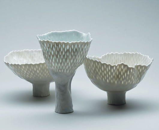 Cornelia Trösch. porcelain vessels with translucent marks, tall feet