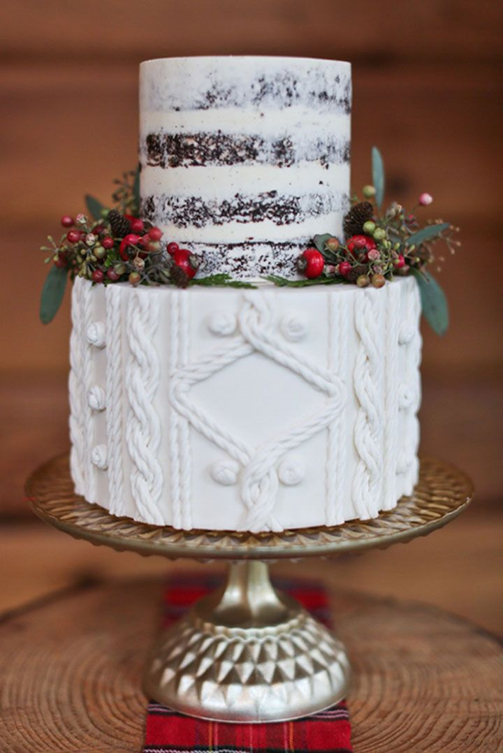 White cake with one layer semi naked and one layer resembling the texture of a sweater and those mini pinecones and berries!