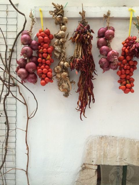 Hanging onions, garlic and peppers in Puglia.
