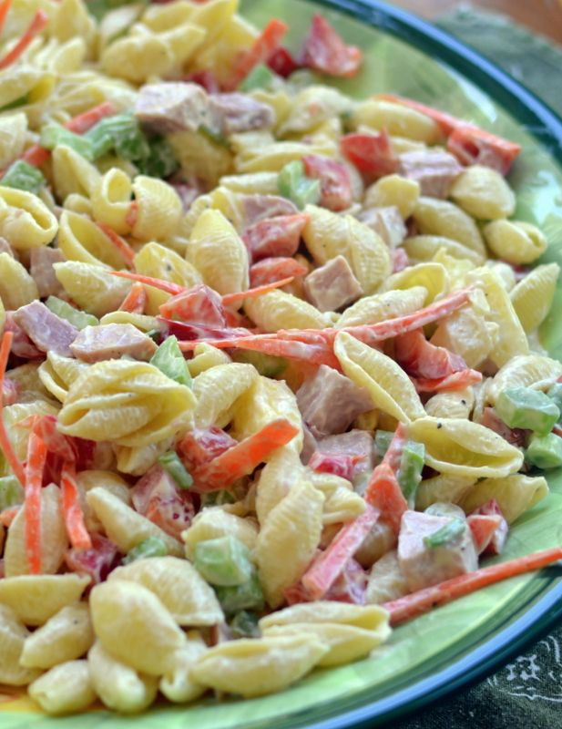 Easy Sweet Hawaiian Pasta Salad brings ham, pineapple, green onion, red pepper and carrots together in a lightly sweetened creamy base of mayo and yogurt.