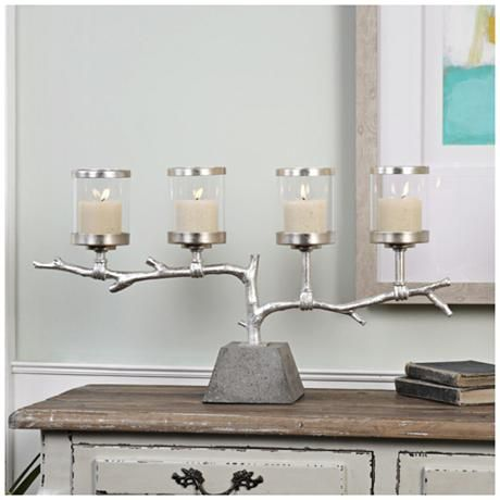 Sporting a wonderful branch design, this transitional pillar candleholder is perfect for bolstering a simple, warm aesthetic.