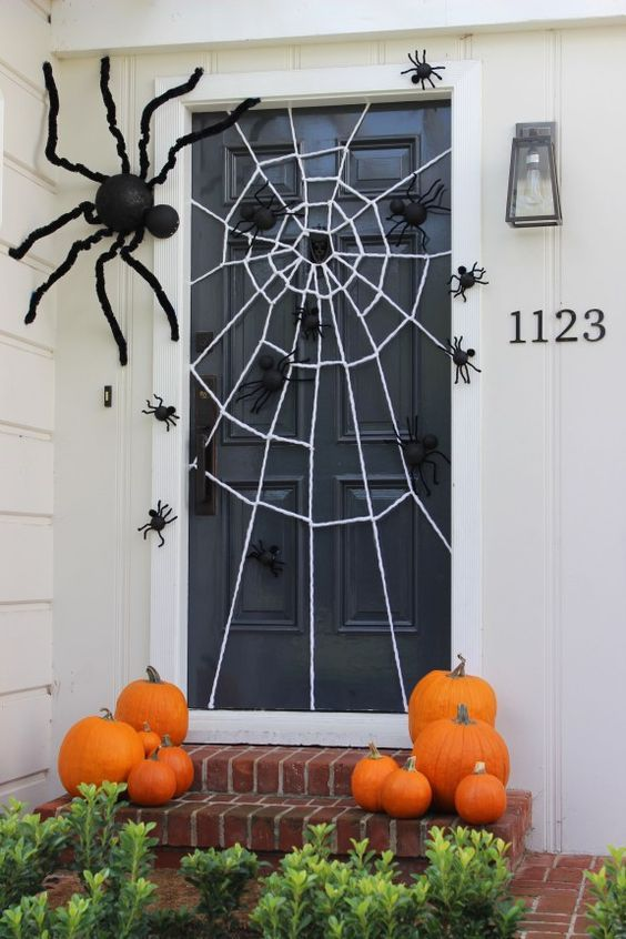 festive halloween door decoration with a diy giant spider web and spiders big