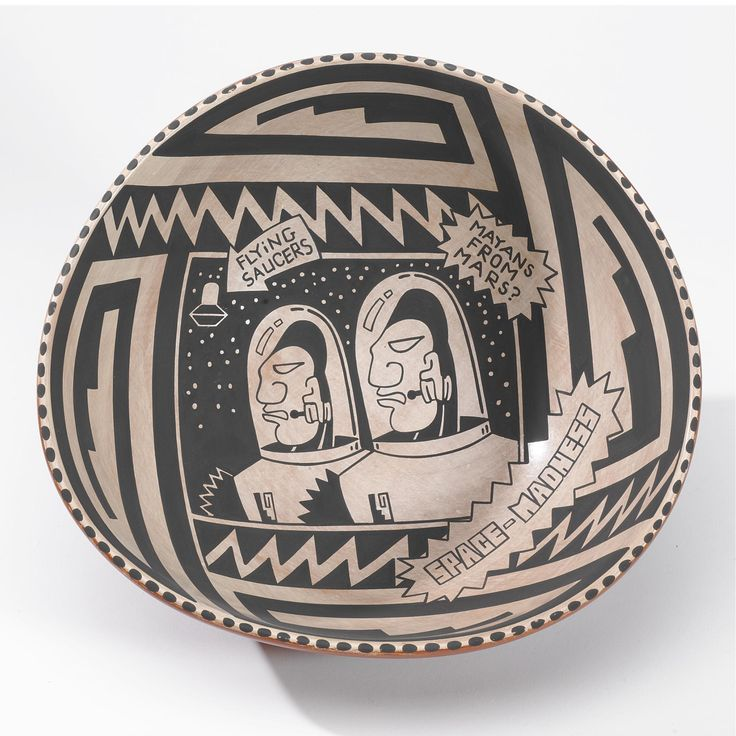 """Diego Romero, Cochiti a bowl, of deeply flaring form, painted on the interior in black and white, with two astronauts, and three zigzag panels enclosing the phrases """"SPACE-MADNESS,"""" """"Flying Saucers,"""" and """"Mayans From Mars,"""" the exterior decorated with a polished red slip and signed: """"Space Madness by Chongo."""" diameter 10 1/2 in. Sotheby's. AMERICAN INDIAN ART 18 May 2007. NY."""