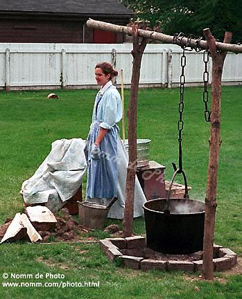 washing clothes with a large cast iron pot