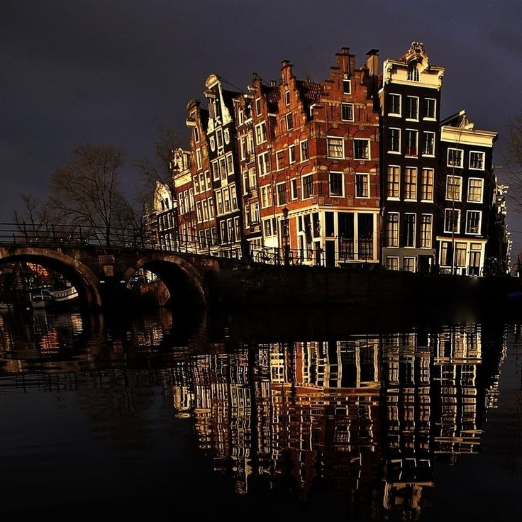 Amsterdam ~ love how the buildings all lean in.