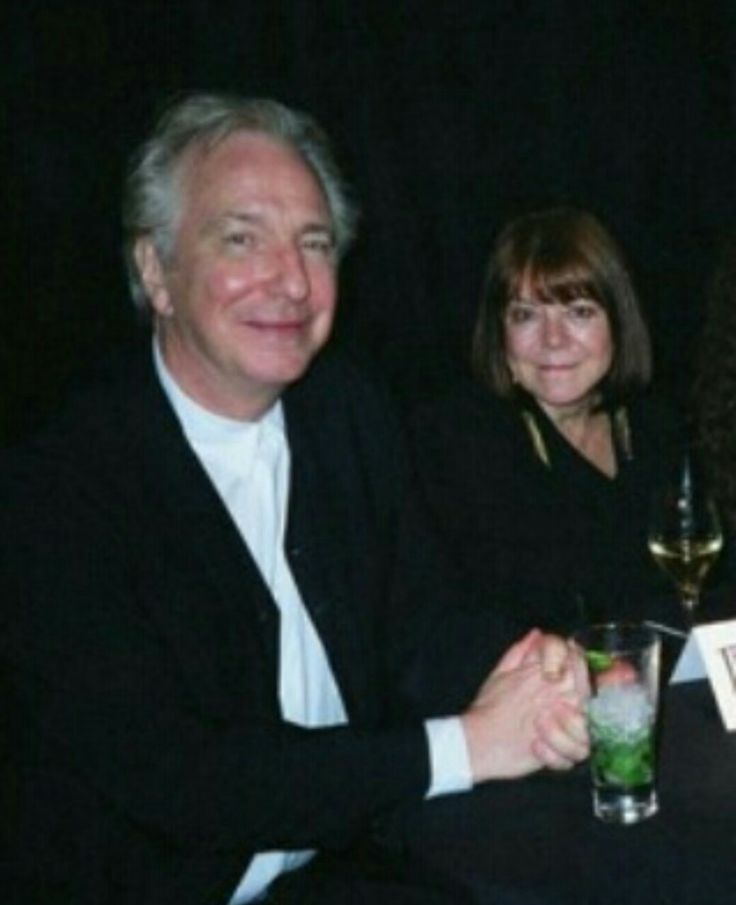 """Alan Rickman and Rima Horton at the London premiere of """"Harry Potter and the Deathly Hallows: Part 2"""", July 7, 2011 (with his nieces who were cropped out of picture)"""