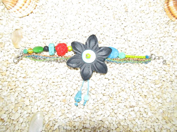 Handmade leather bracelet (1 pc)  Made with leather flower, colourful chains, gemstones and glass beads.