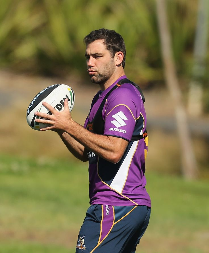Cameron Smith of the Storm passes the ball during a Melbourne Storm NRL training session at Gosch's Paddock on April 10, 2013 in Melbourne, Australia.