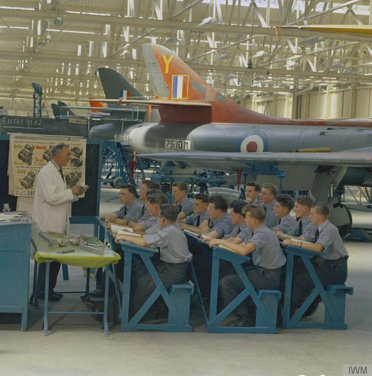 Aircraft Apprentices of the 91st Entry at No 1 School of Technical Training at Halton, Buckinghamshire receiving 'Final Airframes' training from instructor Mr Maynall in a classroom hangar containing Hawker 'Hunter' F.1 instructional airframes, July 1959