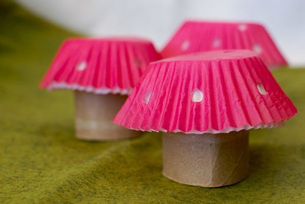 more mushrooms... toilet paper and muffins cups.... could I do this with cookies and decorated rolled up paper? hmmm...