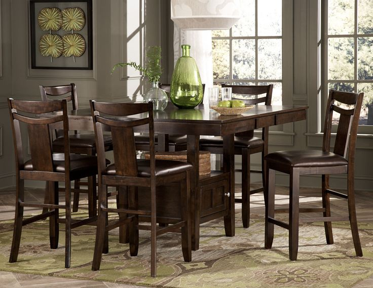 Broome 7Pcs Counter Height Dining Set 2524(Counter Height Table,6 Counter Height Chairs)With just a hint of Craftsman styling and a defined transitional look, the Broome Collection provides you and your family ample space to enjoy your time together. The dark brown finish on hardwood veneers adds to the classic look of the collection. The counter height tabletop expands to seat eight comfortably and is supported by a storage base. The warm brown bi-cast vinyl seat of the chairs blends…