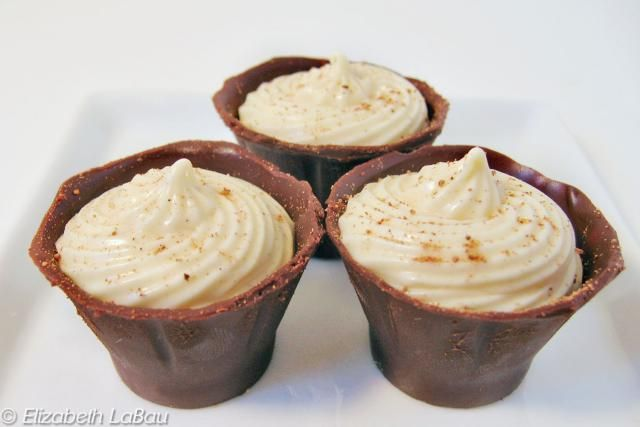 This recipe for Eggnog Truffle Cups features creamy eggnog-flavored truffle cream in a dark chocolate cup.