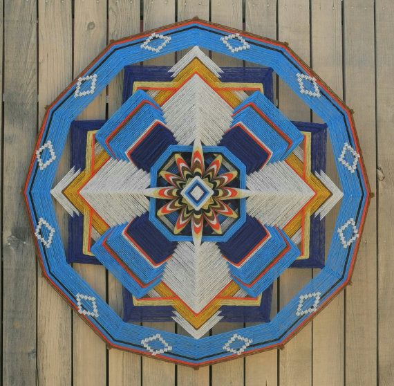 Serendipity, a 36 inch Ojo de Dios, with hand spun natural dyes wool yarn from Teotitlan, Mexico