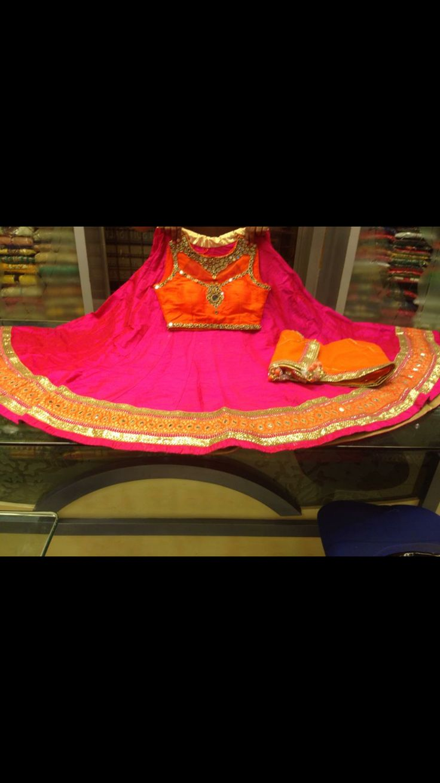 Orange and pink silk chaniya choli with mirror work. Only at www.gujaratidresses.com