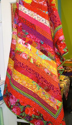 Kaffe Fassett...Love the colors in this quilt! Maybe do a table runner from leftover workshop fabrics?
