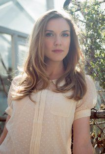 Sara Canning looking radiant and effortless in a creamy t-shirt blouse, and soft tousled hair.