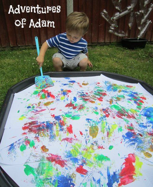 Large scale paint activity: dropping splodges of paint onto a large piece of paper and getting the children to move it around the paper.