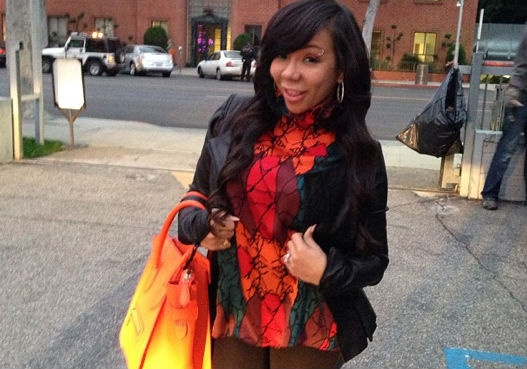 "Tameka ""Tiny"" Harris isn't afraid to add colorful items to her wardrobe!"