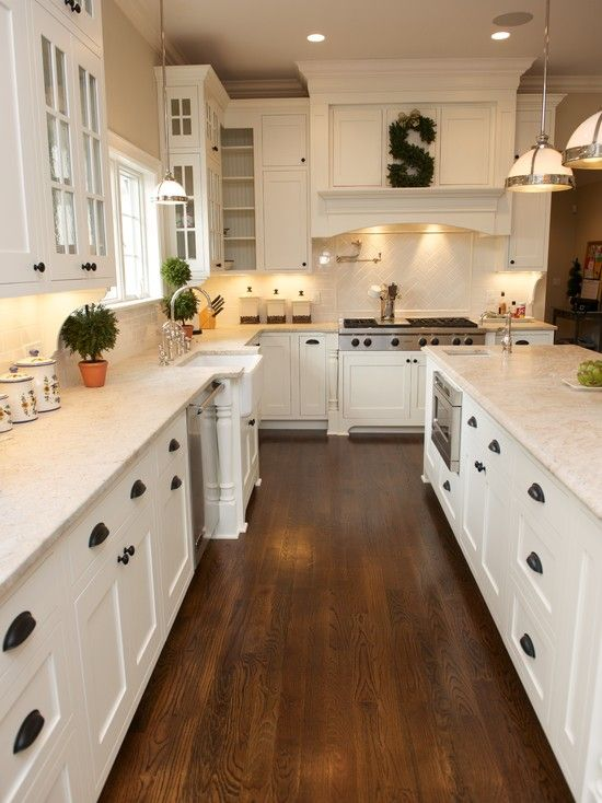 white kitchen, shaker cabinets, hardwood floor, black pulls | for