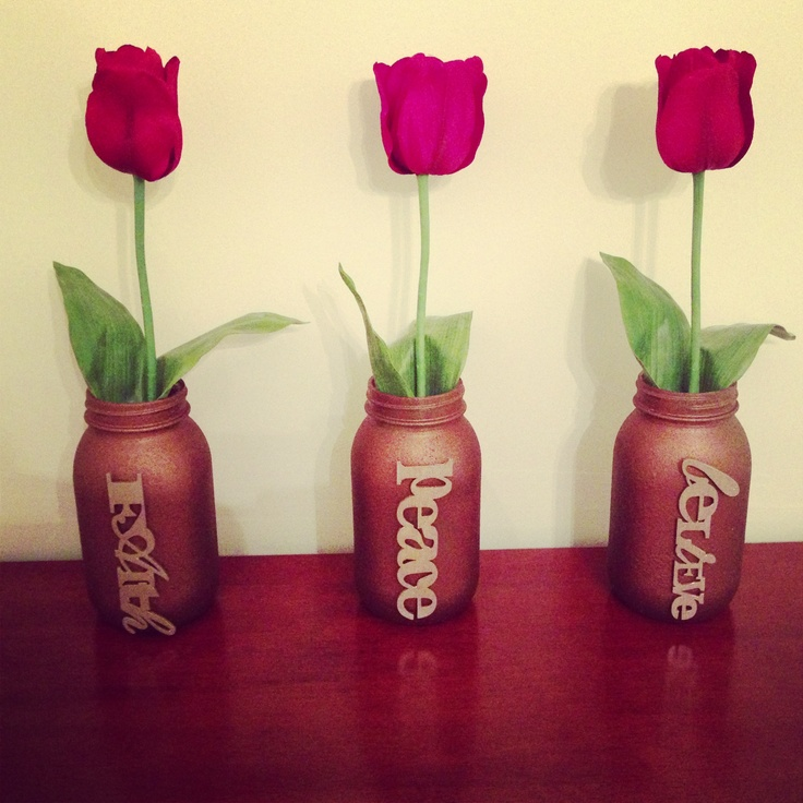 Mason jars with stone metallic spray paint, champagne gold painted letters and red tulips