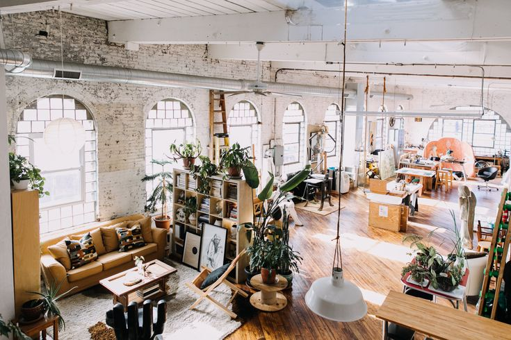 Liz's apartment is on the top floor of an old textile factory, with massive floor-to-ceiling windows. She shares the loft with a local artist who occupies one side.