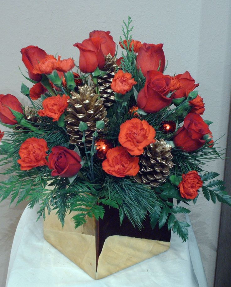 Holiday Centerpieces using a gold cube vase with red flowers and gold accents