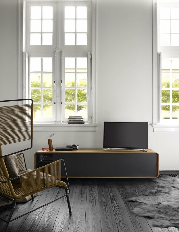 Cemia by Peter Maly - This TV unit completes the Cemia collection. Offering sliding and flap doors, shelves, and niches, this unit is versatile enough to complete any room nicely.