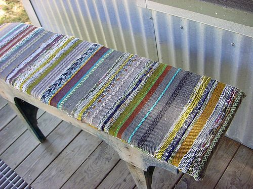 This bench looks like it was made with pallet wood. :)