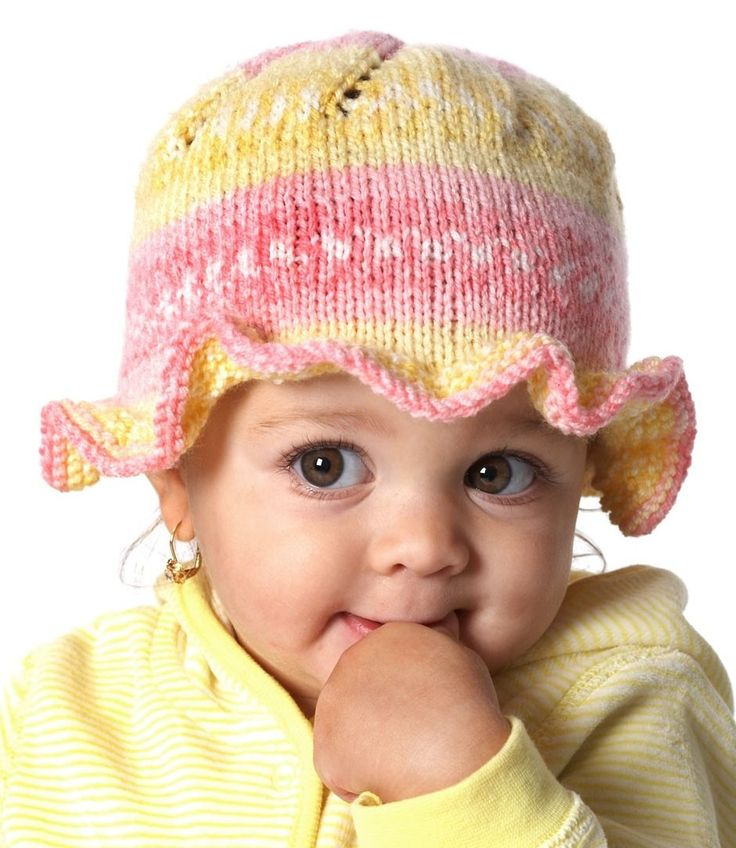 Free Knitting Pattern for Ruffle Baby Sun Hat - Sweet knit cap features a pretty ruffle around the brim. To fit child sizes 6-24 mos. Great with self-striping or self-patterning yarn. Available in English, Spanish, and French.