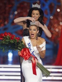 Miss New York Mallory Hagan is crowned Miss America 2013 by Miss America 2012 Laura Kaeppeler on Saturday in Las Vegas