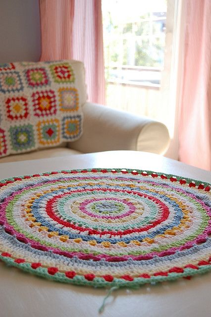 cool crochet rug (love the afghan in the background, too): Throw Rugs, Crochet Granny, Double Crochet, Color, Stools Covers, Crochet Mandala, Crochet Rugs, Granny Squares, Beautiful Crochet