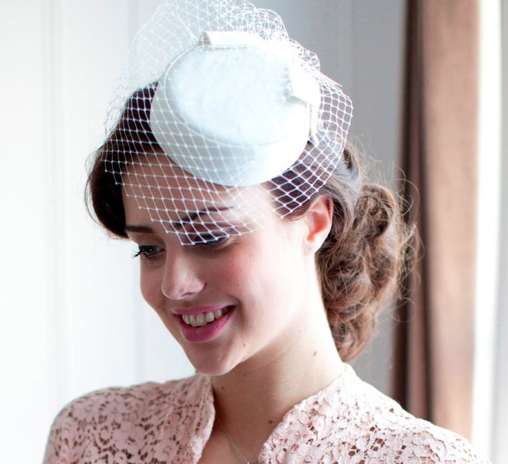 Ivory Pillbox Hat with birdcage veil. 1950s,1960s Style in White, ivory, cream, Champagne, pink or black. $245.00, via Etsy.