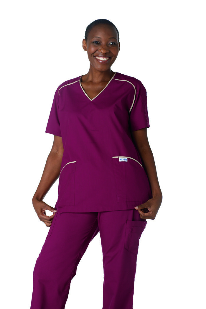 425/312 : Solid Contrast Scrub Top with Flip Flap Pants - Solid contrast scrub top with two lower pockets and one shoulder pen pocket. The Flip Flap Scrub Pant features a classic boot cut fit with a logo waistband that can be flipped down for a lower rise as well as a total of 5 pockets