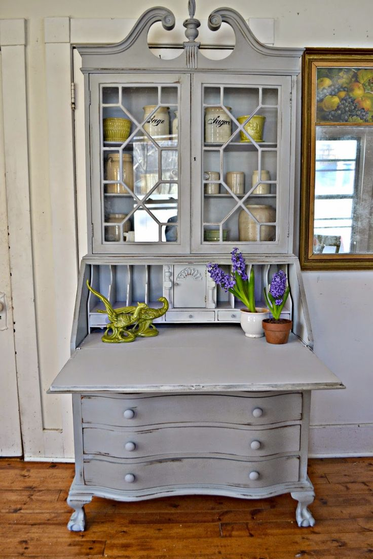 Heir and Space gray painted secretary desk.