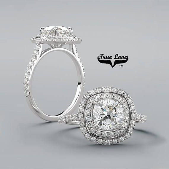 The double halo cushion cut engagement ring. Beautifully set in white gold. Can also be set in rose gold, yellow gold, and platinum.