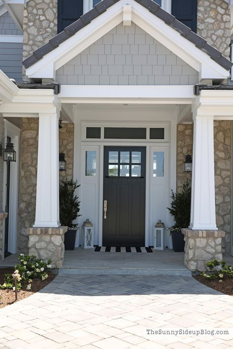 black front door with white sidelights and transom