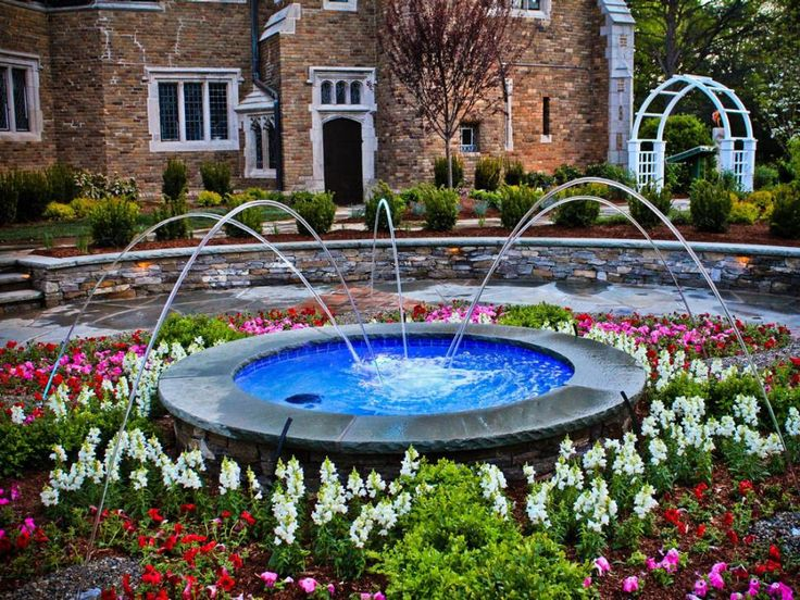 Visitors often let out an impressive sigh of desire when they encounter the front yard of this Morristown, N.J., mansion. Land Identity, LLC, incorporated a seven-foot-in-diameter, formal-style fountain surrounded by flowering annuals and inlay brick.  Click to the next slide to see how the fountain looks at night.
