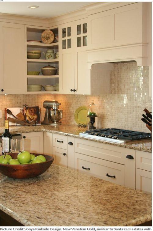 Sonya Kinkade Design. New Venetian Gold, similiar to Santa cecila dates with the perfect backsplash with cream color kitchen cabinets.Backsplash is Botticino Marble Mosaic.