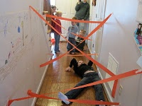 Rainy day activity...  Spy training with tape as lasers!