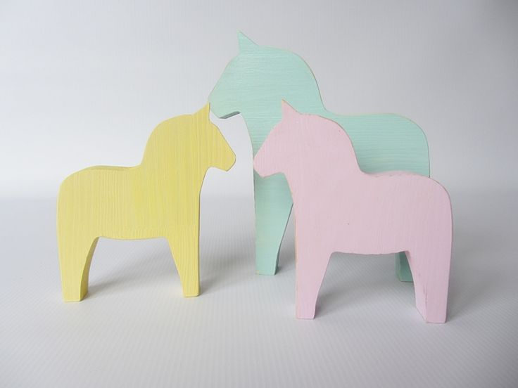 Wooden horses in pastel colours