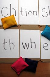Activities: Play Beanbag Letter Blend Toss, Students hear a digraph sound and try to toss beanbags on the corresponding letters. Could use this for multiple phonics concepts.